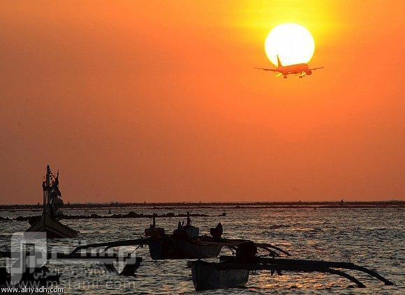 صور جميلة وغريبة وطريفة منظر رائع: طائرة وغروب وبحر