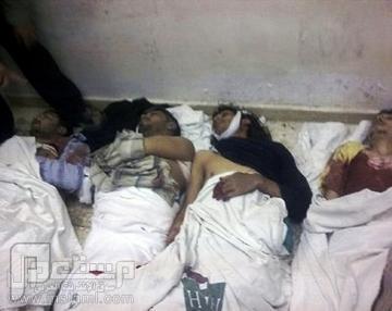 شهيد سوري يكتب بدمه داخل ثلاجة الموتى
