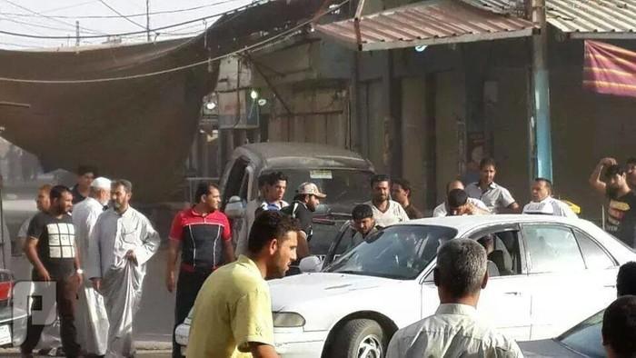 لحضة قصف مدينة الفلوجة بالصور بالبراميل والصواريخ سوق الفلوجة
