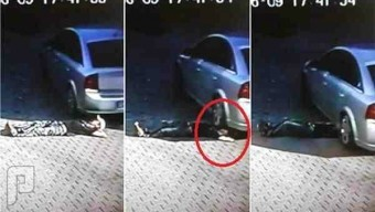 مخمور نجا من الموت رغم مرور السيارة فوق رأسه
