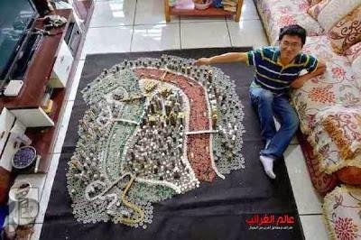 فنان صيني يصمم مدينة بواسطة القطع النقدية