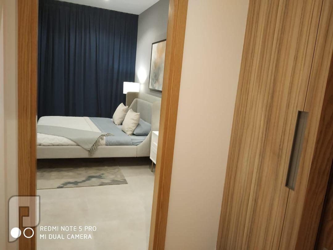 بالتقسيط الميسر تملك شقه غرفتين وصاله  بموقع مميز بدبي