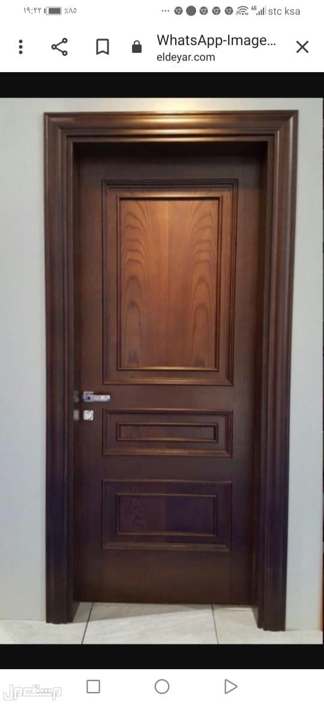 دهان أبواب حديد وخشب