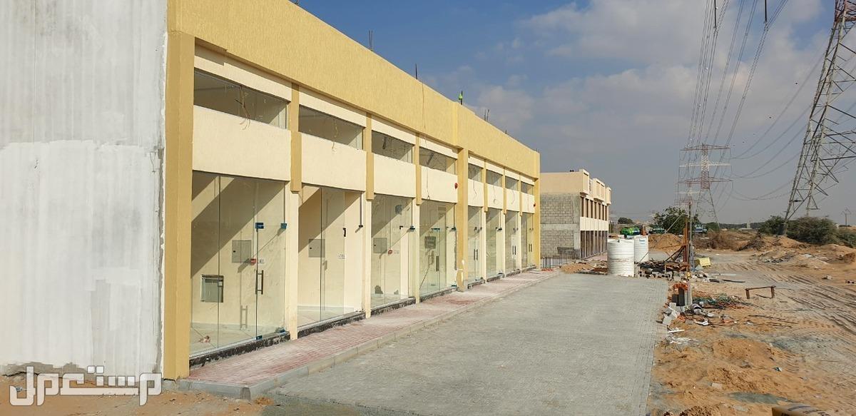 مبنى محلات تجارية للبيع فى الياسمين عجمان-على شارع الزبير-موقع حيوي